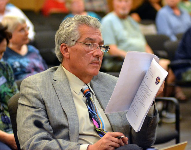 Doña Ana County Manager Fernando Macias looks over a resolution during a September 2018 county commission meeting. On Tuesday, Dec. 11, Doña Ana County commissioners OK'd an amendment to Macias' employment contract, awarding a $20,000 per-year salary increase and some other changes.