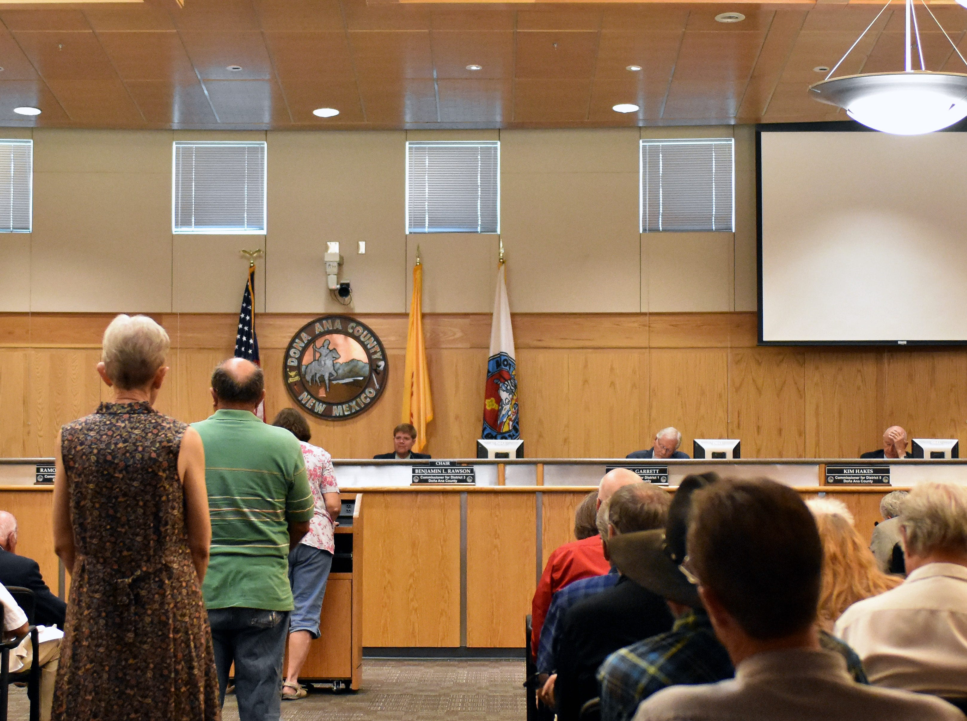 Residents line up to voice their opinions on straight-party voting during a Doña Ana County Commission special meeting Tuesday, Sept. 4, 2018.