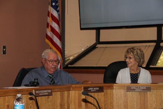 Eddy County Commissioners Larry Wood and Stella Davis discuss Eddy County business during Tuesday's Eddy County Commission meeting.