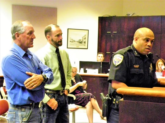 Alamogordo Police Chief Brian Peete, right, speaks about the White Mountain Task Force and High Intensity Drug Trafficking Area program at the Aug. 28, 2018 regular Alamogordo City Commission meeting. Behind Peete are Otero County Magistrate Judge Michael Ryan Suggs and Otero County Sheriff-Elect David Black.