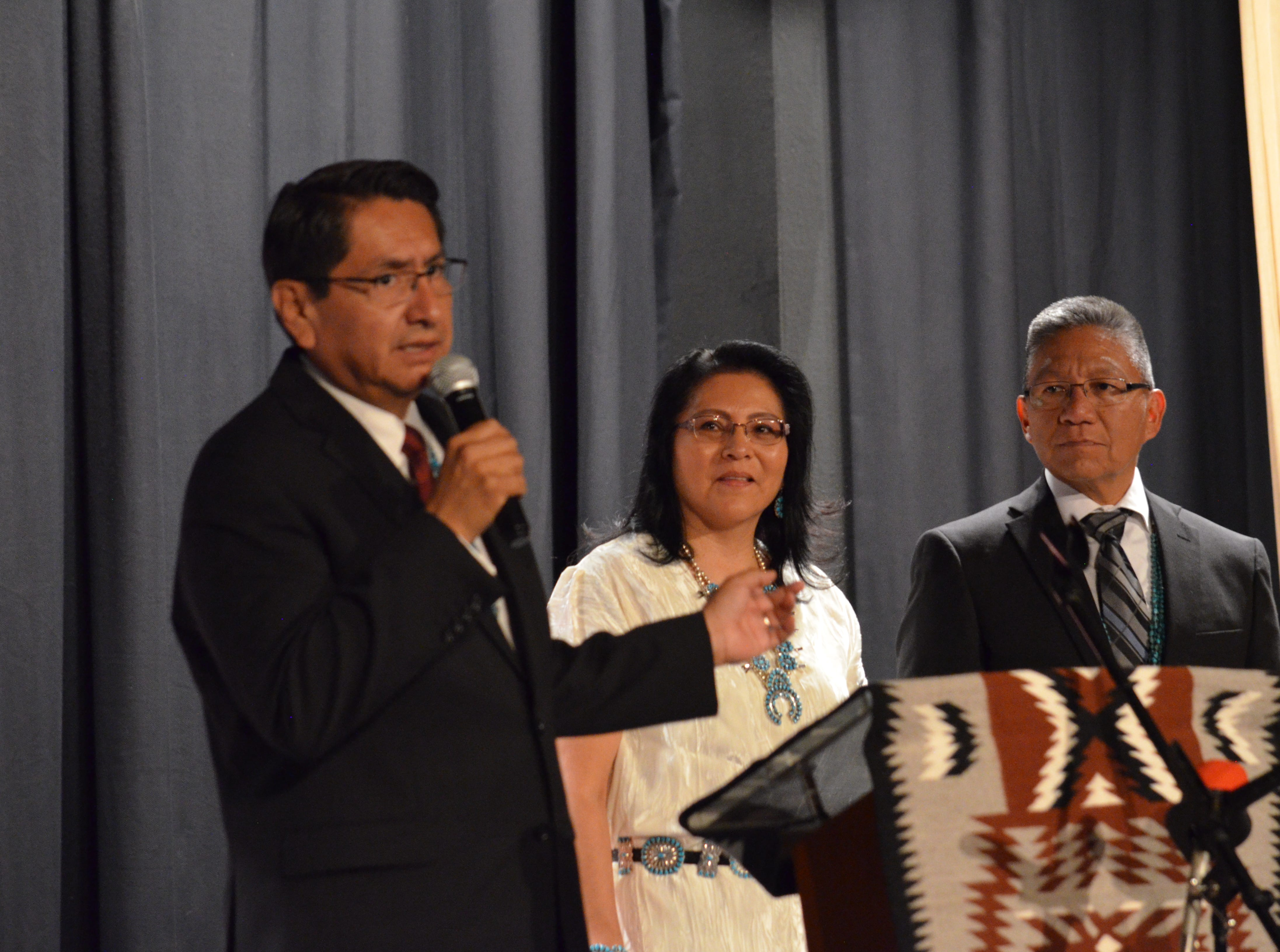 Navajo Nation presidential candidate Jonathan Nez, left, talks about running mate Myron Lizer, third from left. Lizer was joined by his wife, Dottie Lizer, second from left, at the announcement on Tuesday in Window Rock, Arizona.