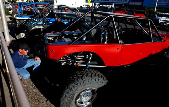 Gene Starks of Durango looks over a rock crawler during the Fall Crawl on Friday Sept. 9, 2016, on Main Street. The car show preceeds the World Extreme Rock Grand National Championship, which takes place Saturday and Sunday at Chokecherry Canyon.