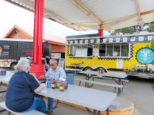 Customers enjoyed barbecue over the weekend at Can't Stop Smokin' serving out of a mobile unit.