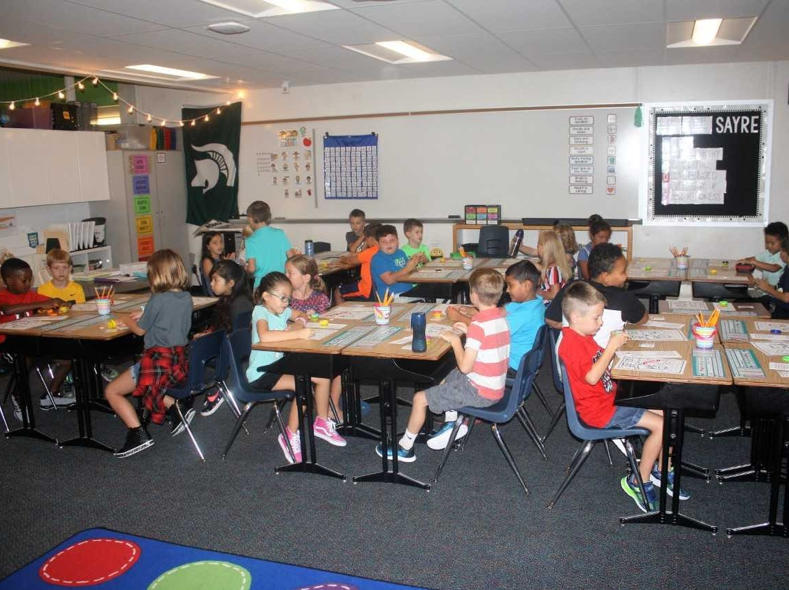 Students are ready to learn during the first day of school at Sayre Elementary School in South Lyon.