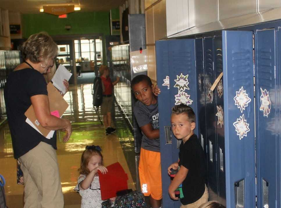 Students organize their lockers moments into their first day of school.