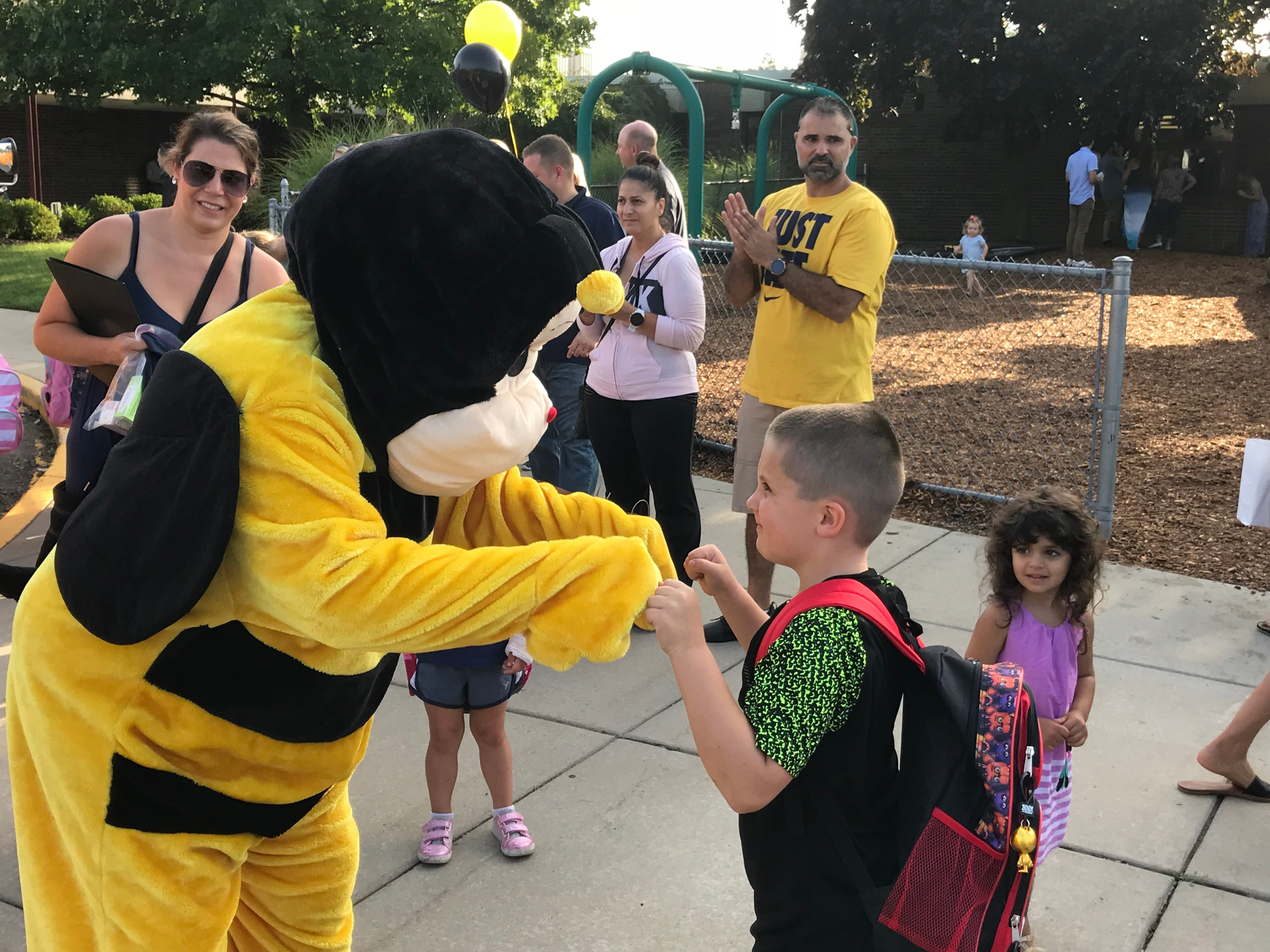 The Isbister Bee welcomes students back on the first day of school at Isbister Elementary School in Plymouth. Plymouth-Canton schools joined districts around the state on Tuesday's first day of school.