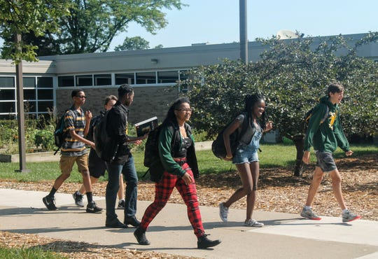 Students are seen outside Groves High School in the Birmingham school district, which has taken some heat lately for the curriculum in an African American history class.
