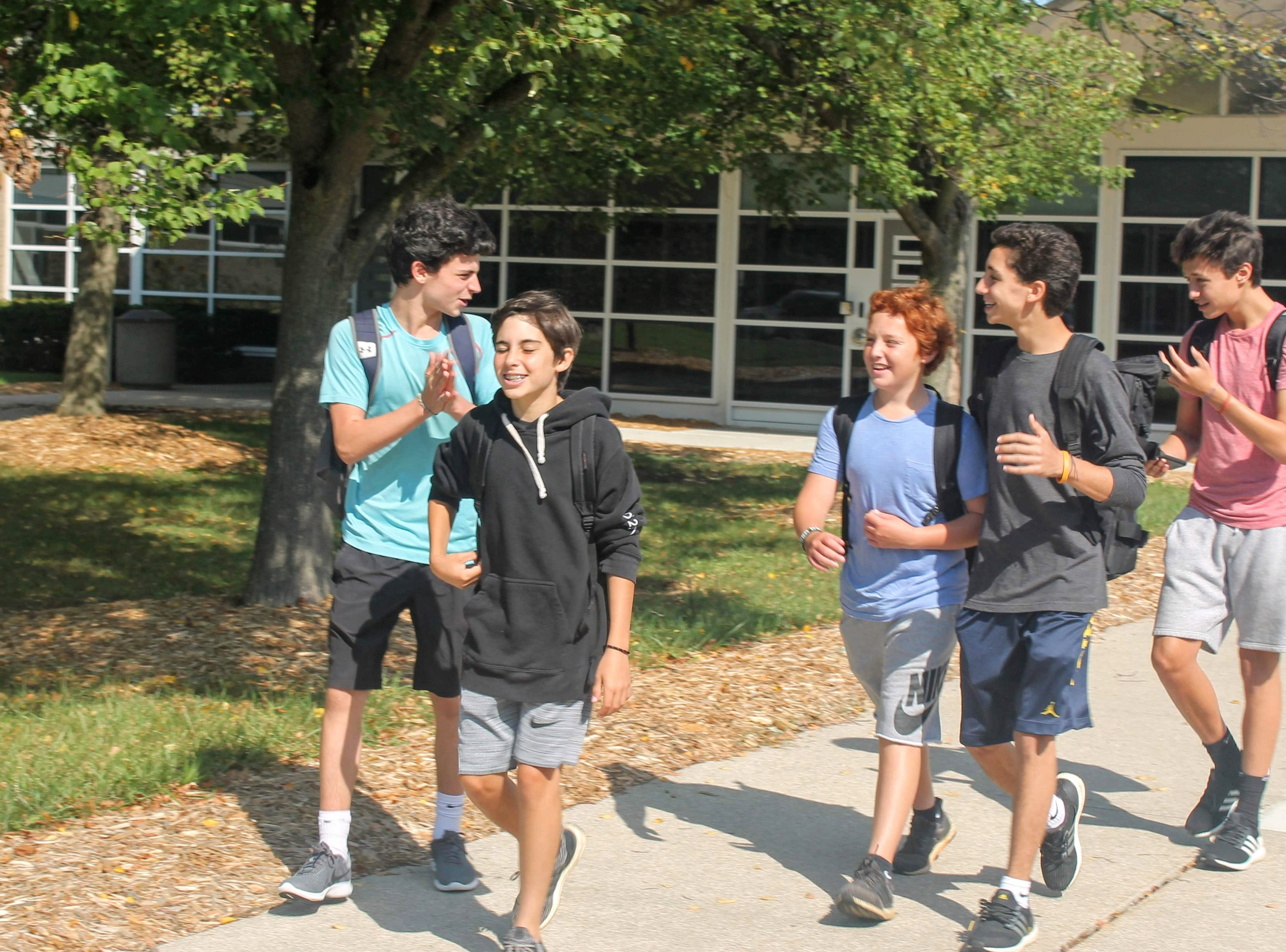 Students walk out of the main entrance along 13 Mile at Groves High School on the first day of school.