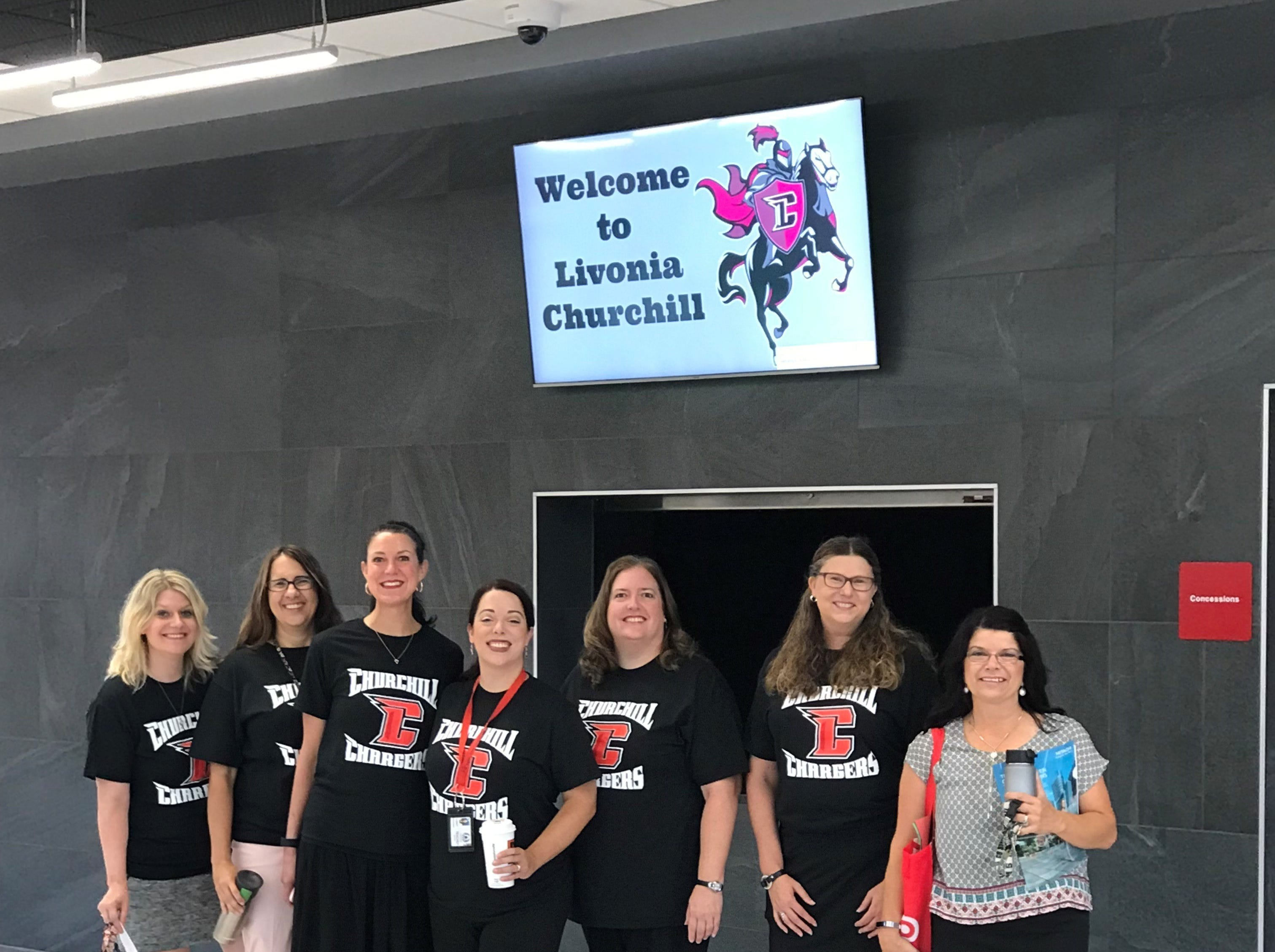 Welcoming faces greeted students returning to Churchill High School Tuesday.