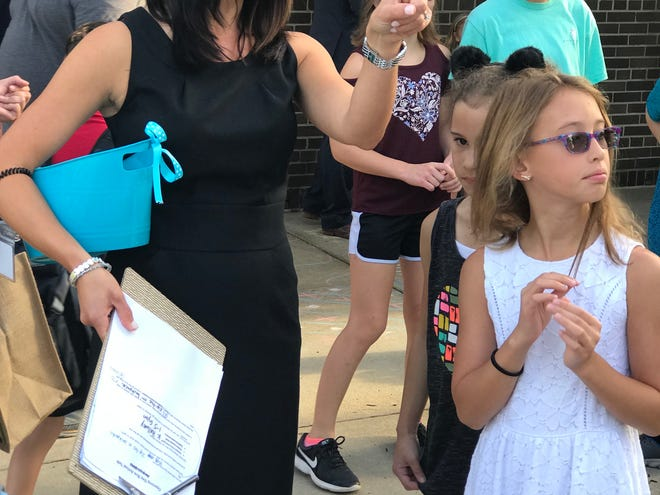 New Isbister Principal Emily Hawthorne talks with fourth-grader Anna Kehoe.
