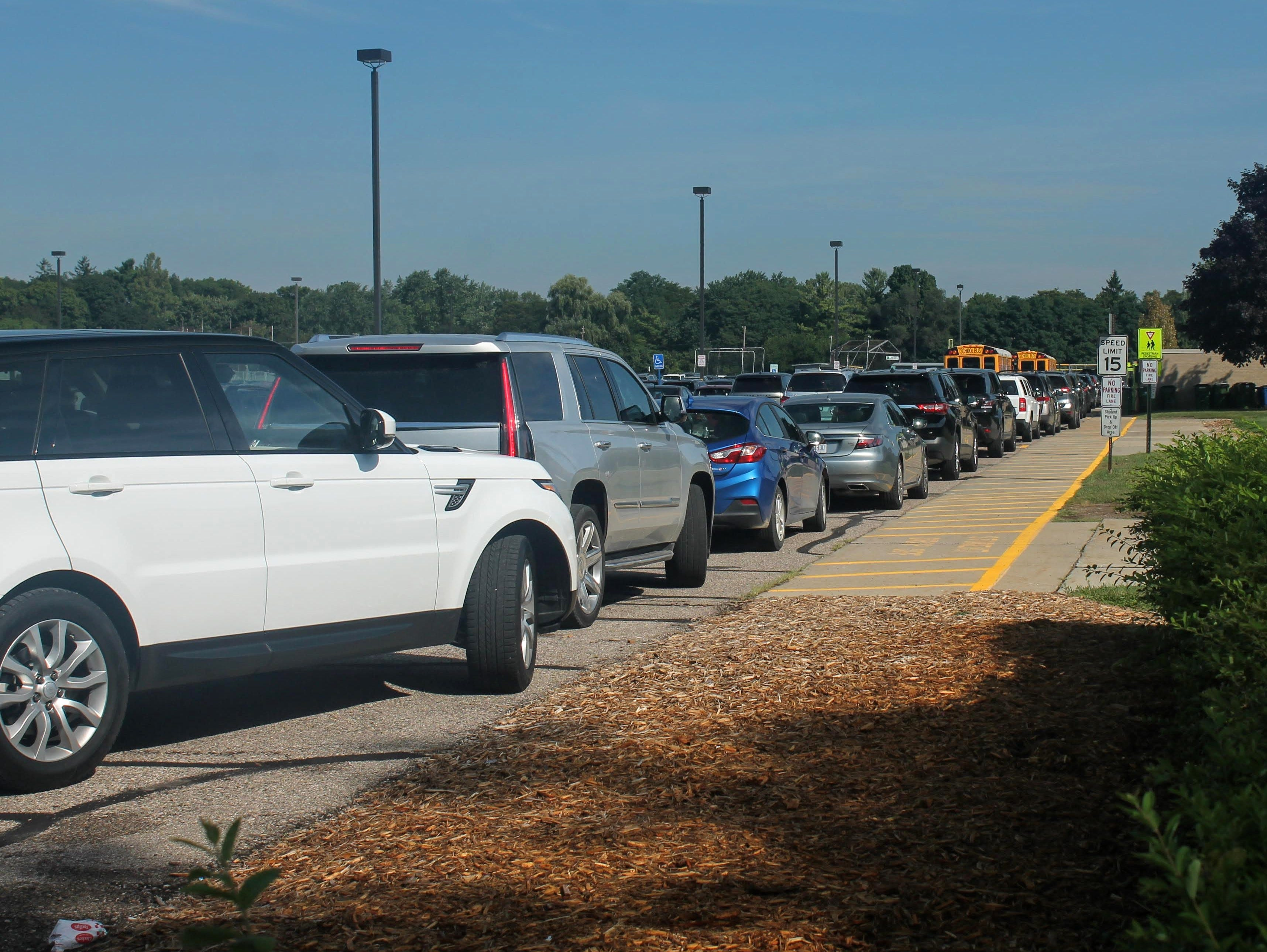 Vehicles line up to pick up students on the first day of school Sept. 4 at Groves High School in Beverly Hills.