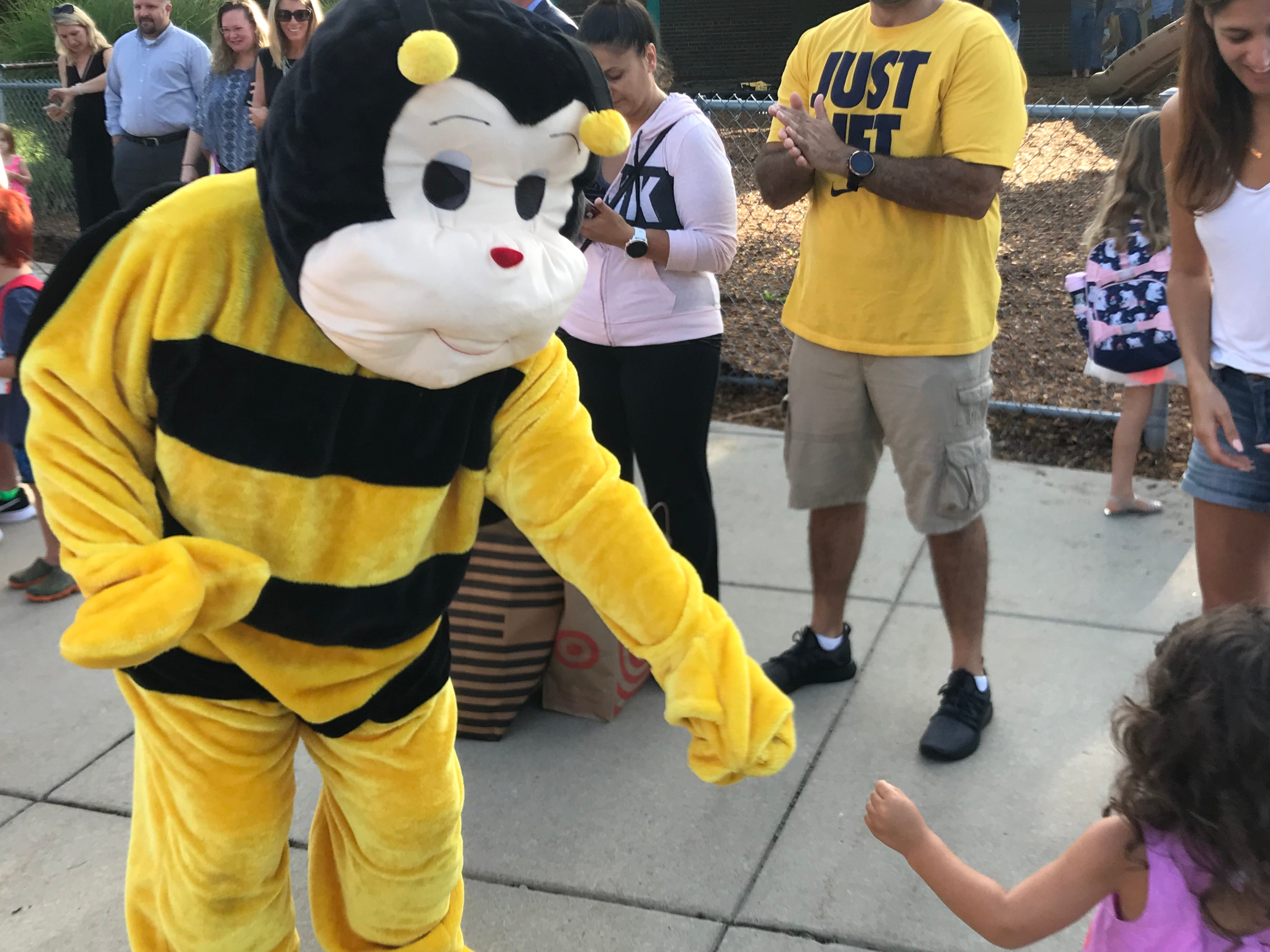 The Isbister Bee welcomes students on the first day.