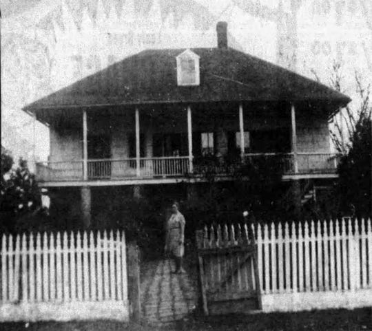 Mrs. Catherine  (Katie) Ringrose shown in front of the home, circa 1920s.