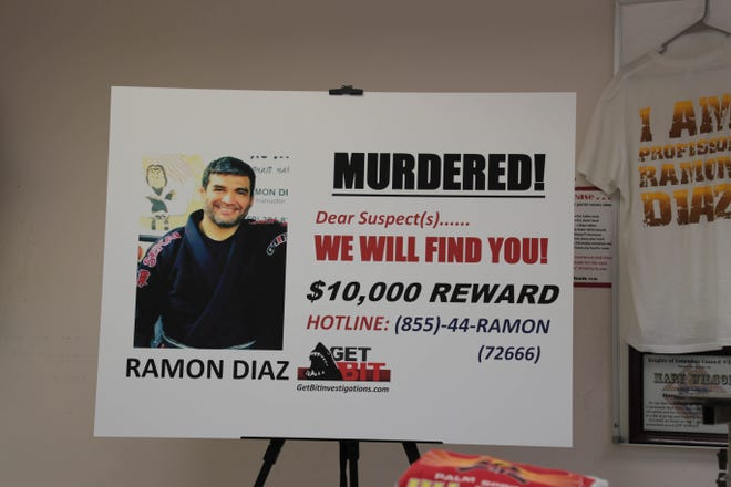 A billboard for Ramon Diaz sits in St. Theresa Church during a press conference on Tuesday, Sept. 4, 2018.