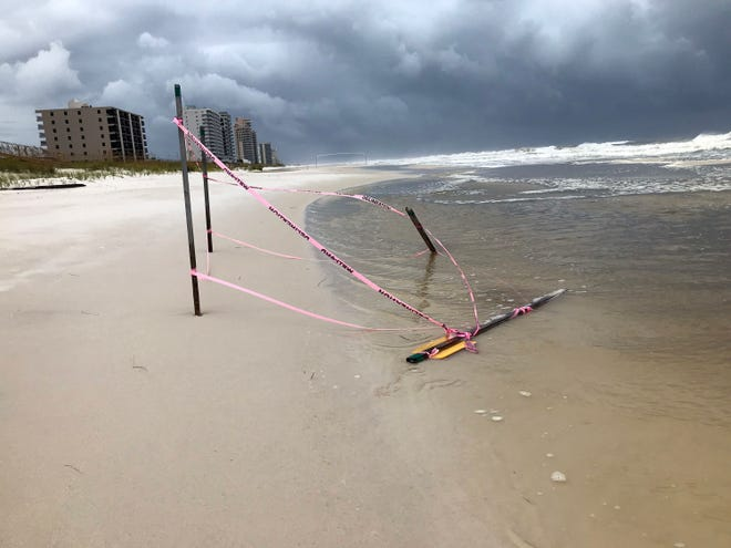 High surf claims a sea turtle nest on Perdido Key as Tropical Storm Gordon churns in the Gulf of Mexico on Tuesday.