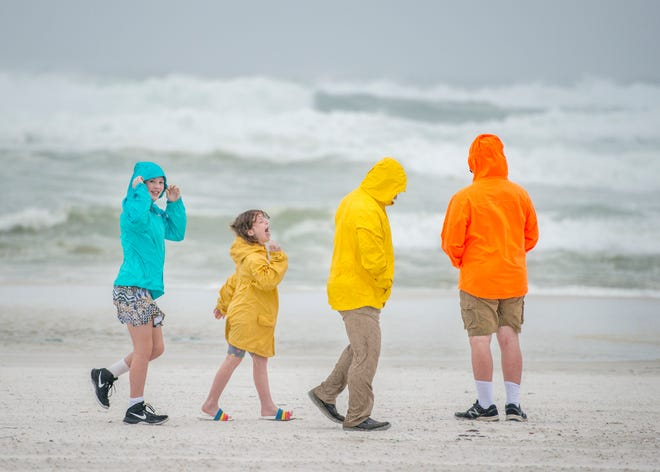 The McGovern family check out the higher than usual waves at Casino Beach as Tropical Storm Gordon approaches the Pensacola area on Tuesday, September 4, 2018.