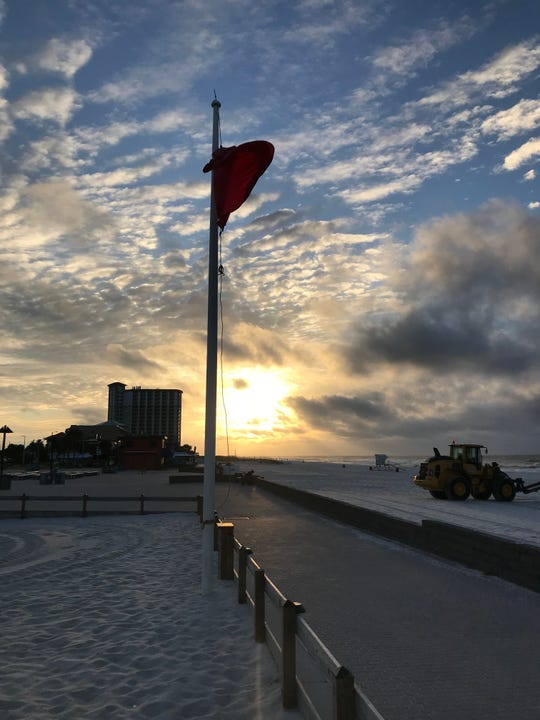 A red flag flies over Pensacola Beach early Tuesdsay morning as Tropical Storm Gordon approaches the northern Gulf Coast.