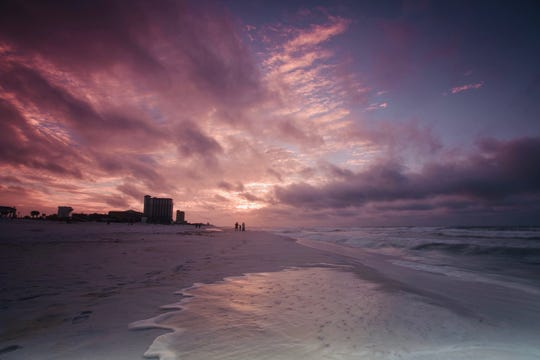 Sunrise over Pensacola Beach Tuesday morning as Tropical Storm Gordon churns in the Gulf.