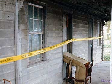 Crime scene tape surrounds the Oxford Township home of Edna Laughman, who was raped and murdered on August 13, 1987.