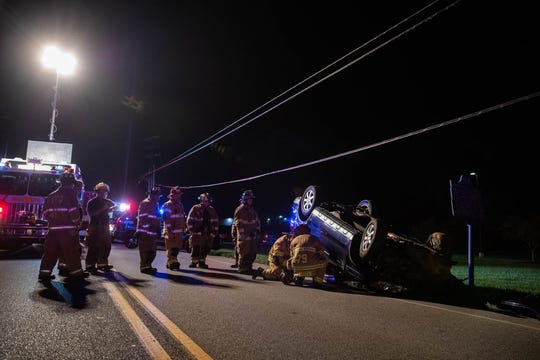 Firefighters work at the scene of a vehicle crash with rollover on the 1200 block of York Street, Sept. 3, 2018, in Penn Township. The crash only involved one vehicle and resulted in one patient being taken to the hospital, said Sgt. Travis Shearer of Penn Township police.The cause was under investigation, he said.