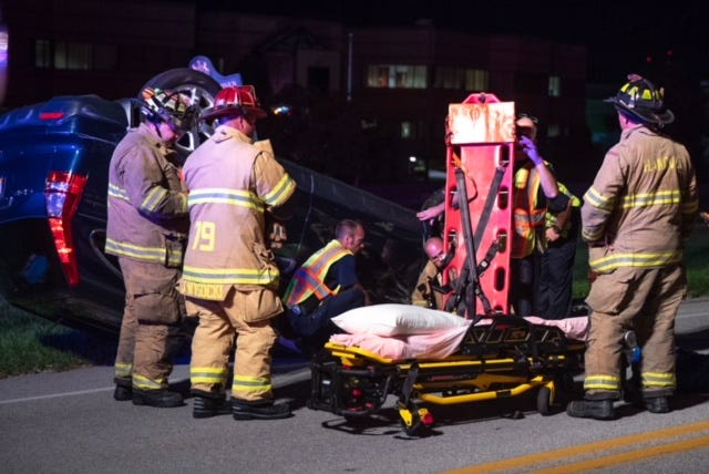 Firefighters and paramedics prepare to put a patient onto a backboard at the scene of a vehicle crash with rollover on the 1200 block of York Street, Sept. 3, 2018, in Penn Township. The crash only involved one vehicle and resulted in one patient being taken to the hospital, said Sgt. Travis Shearer of Penn Township police.The cause was under investigation, he said.
