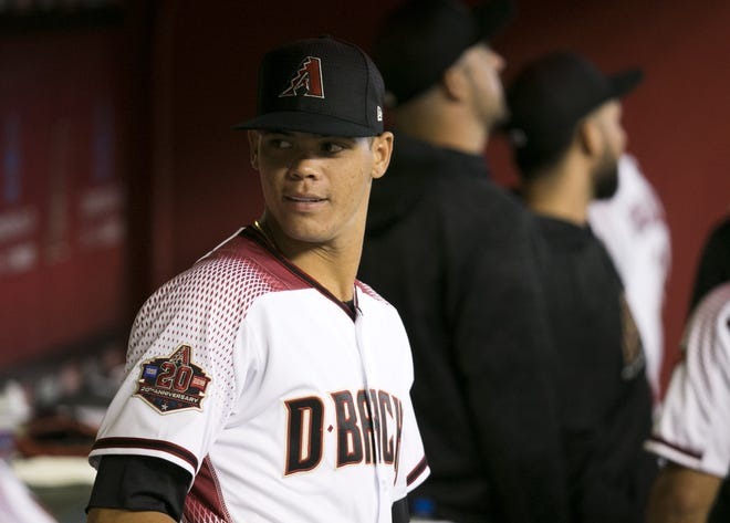 Diamondbacks pitcher Yoan Lopez looks on in the dugout before the start of the major league baseball game against the Padres at Chase Field in Phoenix on Monday, September 3, 2018.