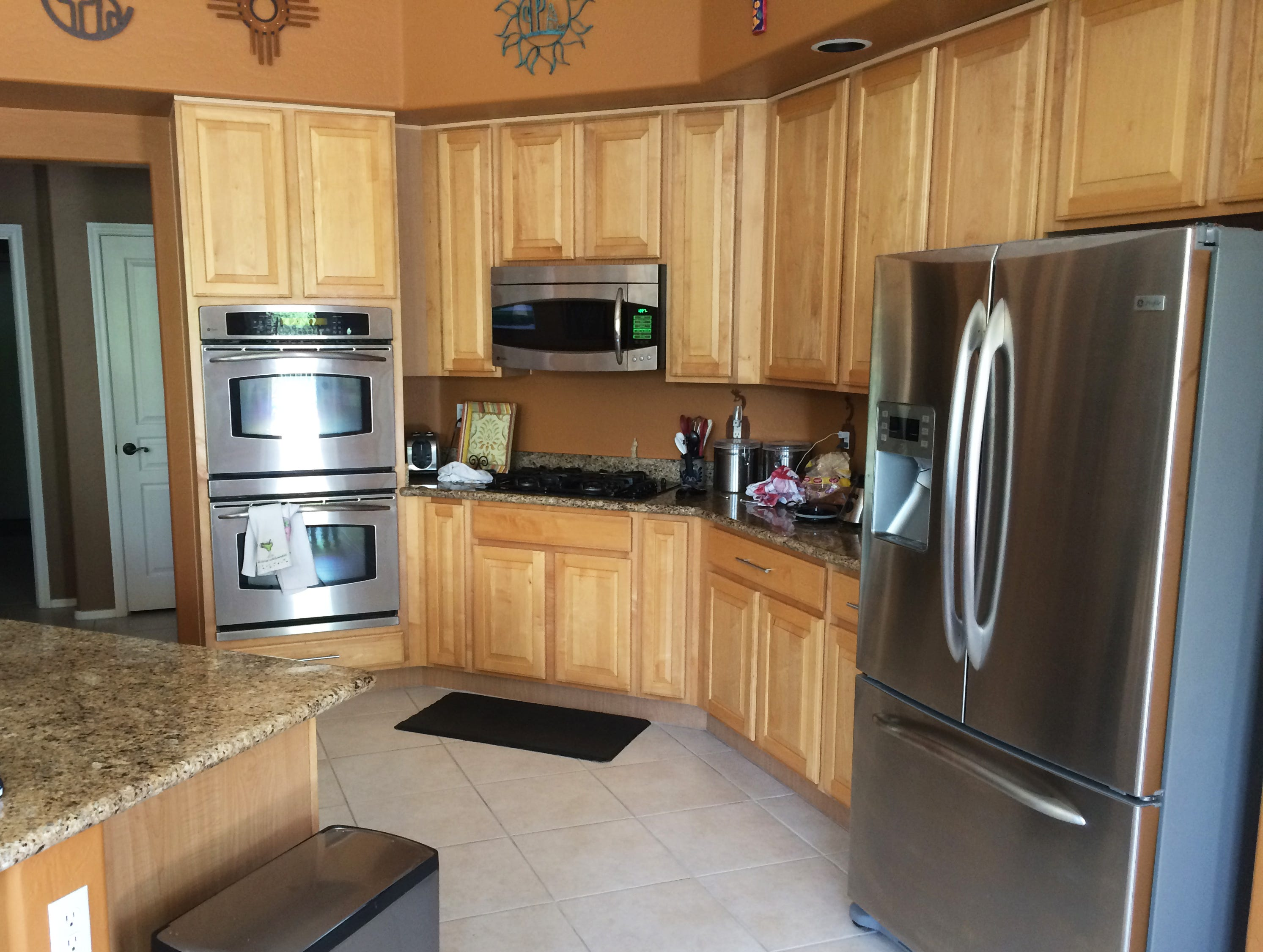 What the kitchen looked like when the couple purchased it in 2012. They hired interior designer Rebecca Arteaga to help them achieve a more contemporary look.