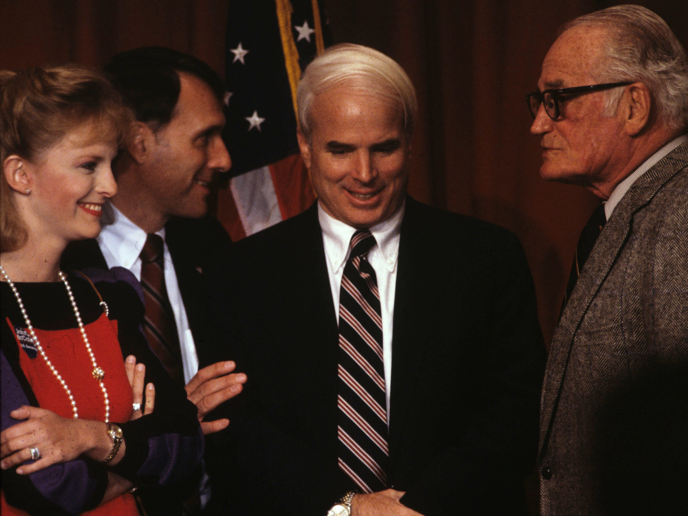 Arizona Congressional Representative John McCain, center talks with Arizona Senator Barry Goldwater, right and McCains wife Cindy at a 1988 fund raiser at the Arizona Biltmore Hotel. Left rear is Jon Kyl.