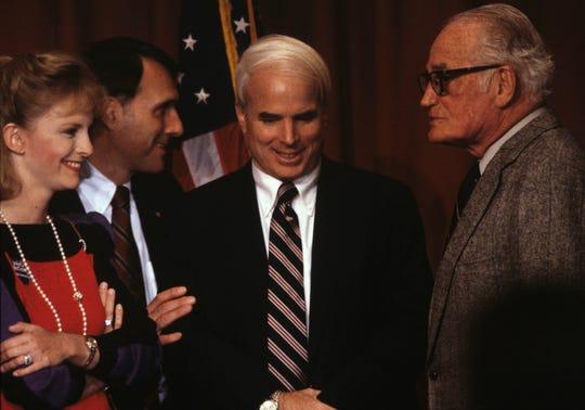 Arizona Congressional Representative John McCain, center talks with Arizona Senator Barry Goldwater, right and McCains wife Cindy at a 1988 fund raiser at the Arizona Biltmore Hotel. Left rear is Jon Kyl.