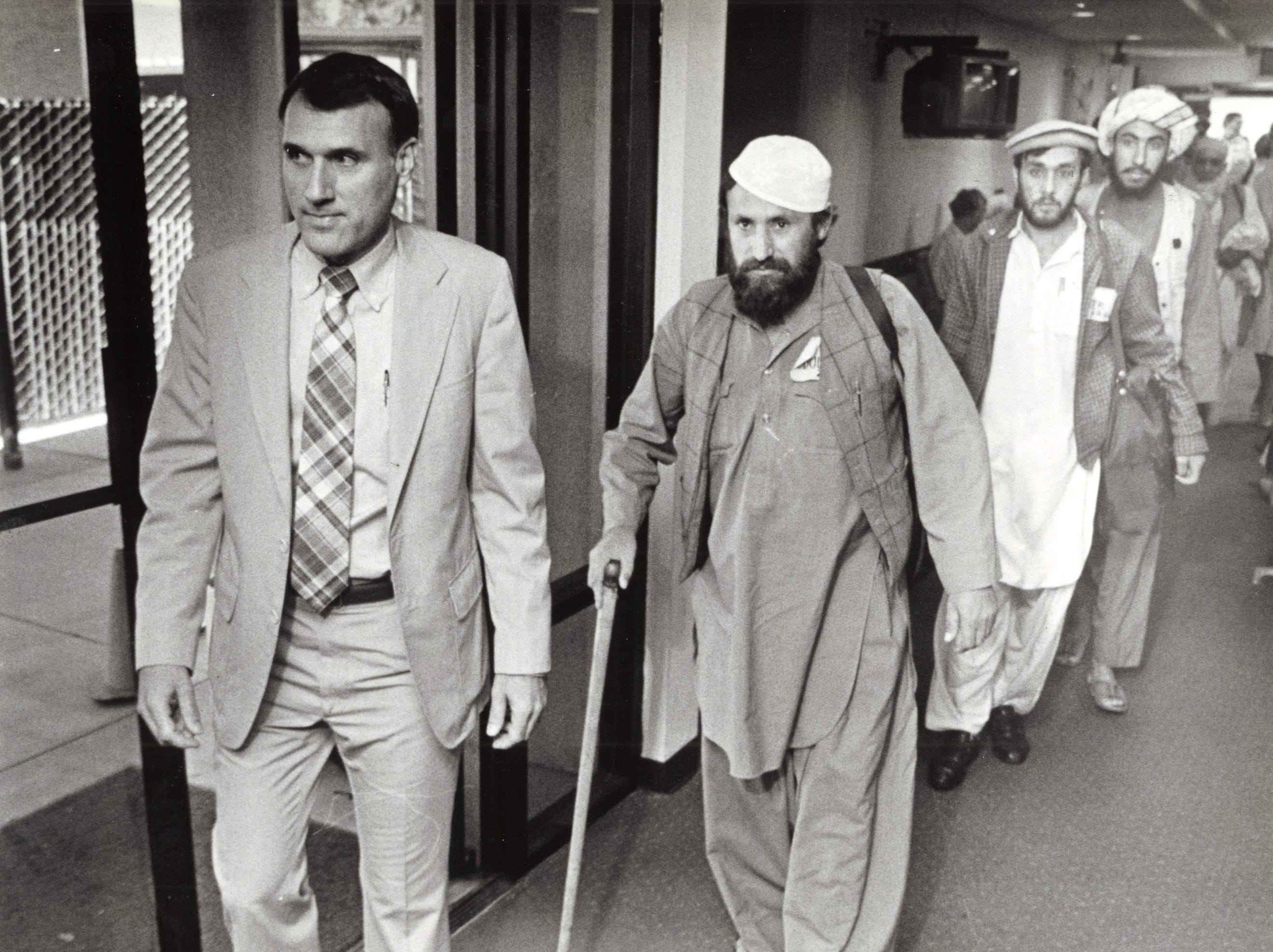 Arizona Rep. Jon Kyl walks with Afgan freedom fighters who were wounded by Russians in their home country, May 26, 1987.