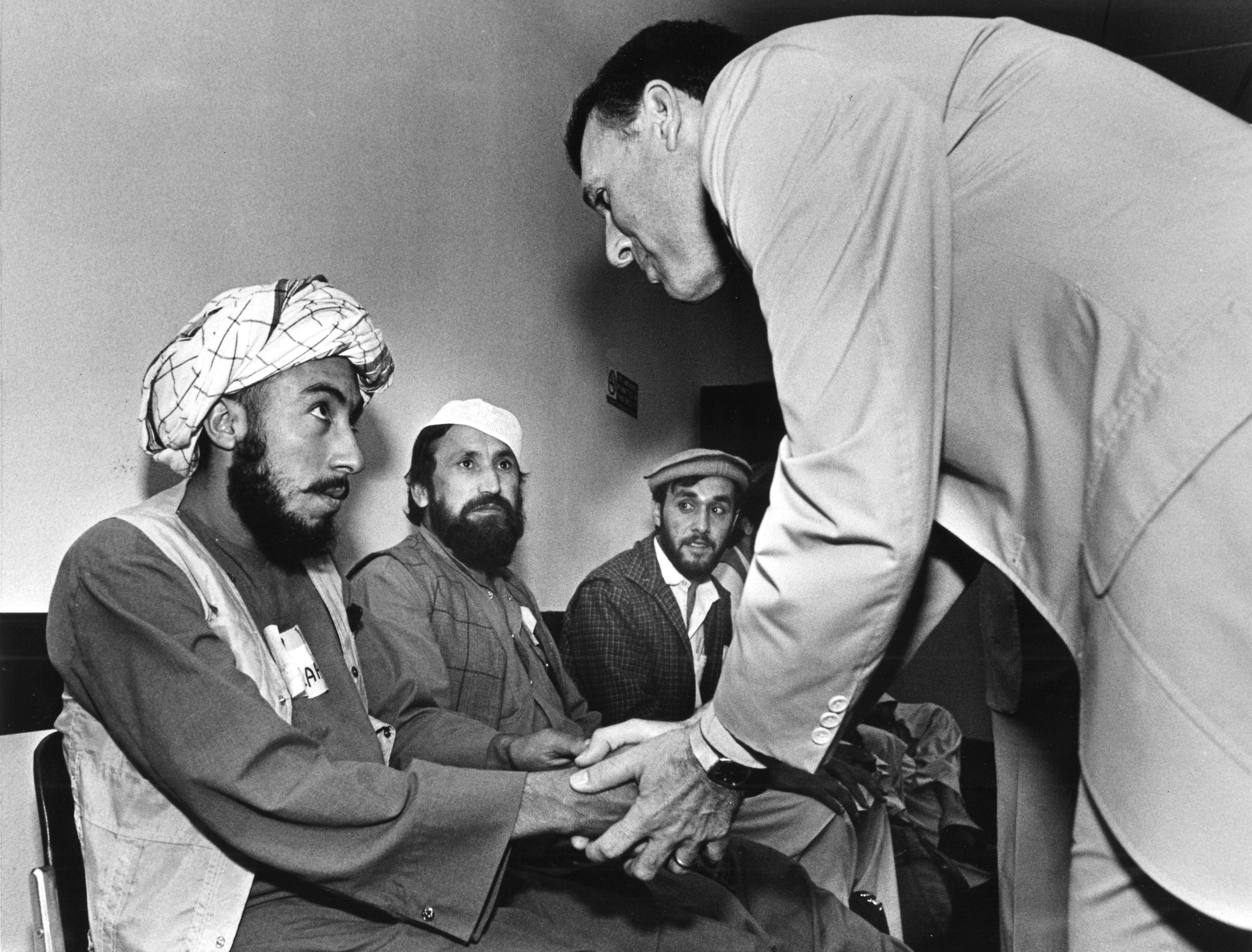 Congressman Jon Kyl greets Afghan rebels at Phoenix Sky Harbor Airport, May 26, 1987.
