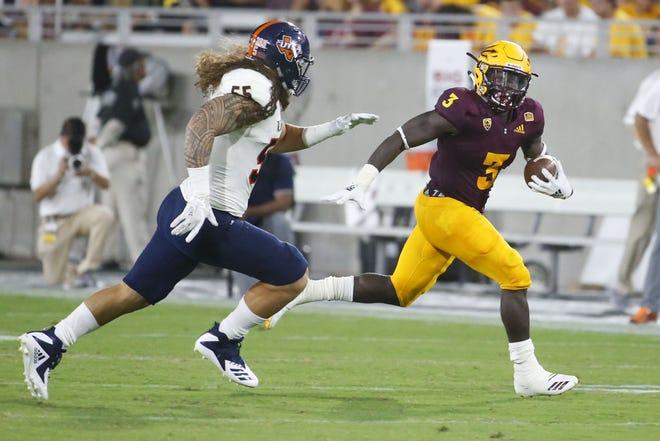 UTSA Roadrunners linebacker Josiah Tauaefa (55) attempts to tackle Arizona State Sun Devils running back Eno Benjamin (3) during a football game at Sun Devil Stadium in Tempe on September 1, 2018.