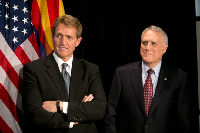 U.S. Senator Jeff Flake (left) and former U.S. Senator Jon Kyl listen during a press conference at the Heard Museum, Feb. 7, 2014. The press conference announced that APS donated one million dollars for trail maintenance at Grand Canyon National Park.