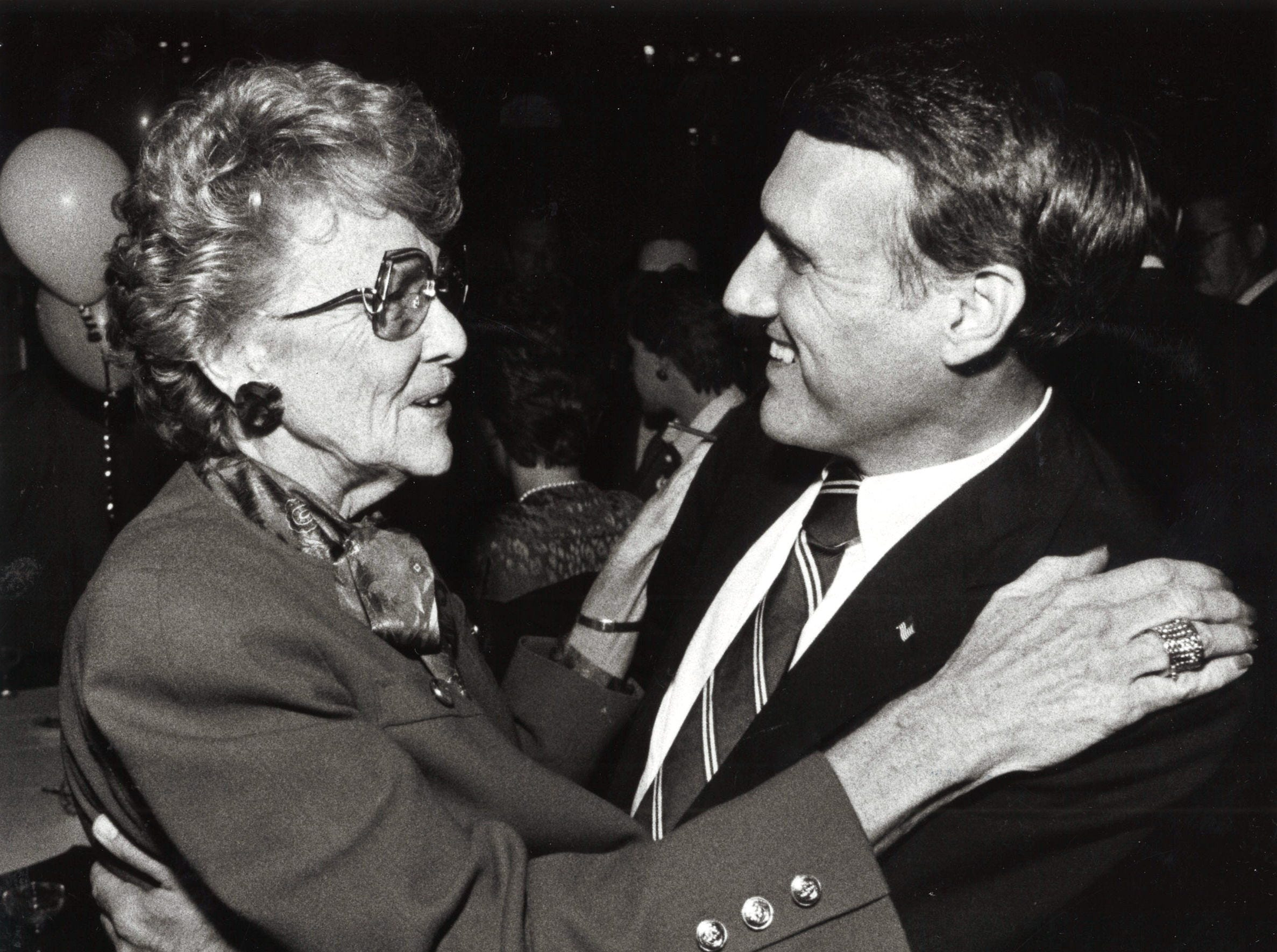 Former Phoenix Mayor Margaret Hance gives Jon Kyl a congratulatory hug Tuesday night at his victory reception at the Heritage Hotel, Nov. 4, 1986.