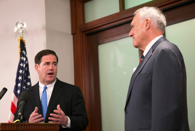 Gov. Doug Ducey announces the appointment of former U.S. Sen. Jon Kyl to the late Sen. John McCain's Senate seat as Kyl looks on at the state Capitol on Sept. 4, 2018.