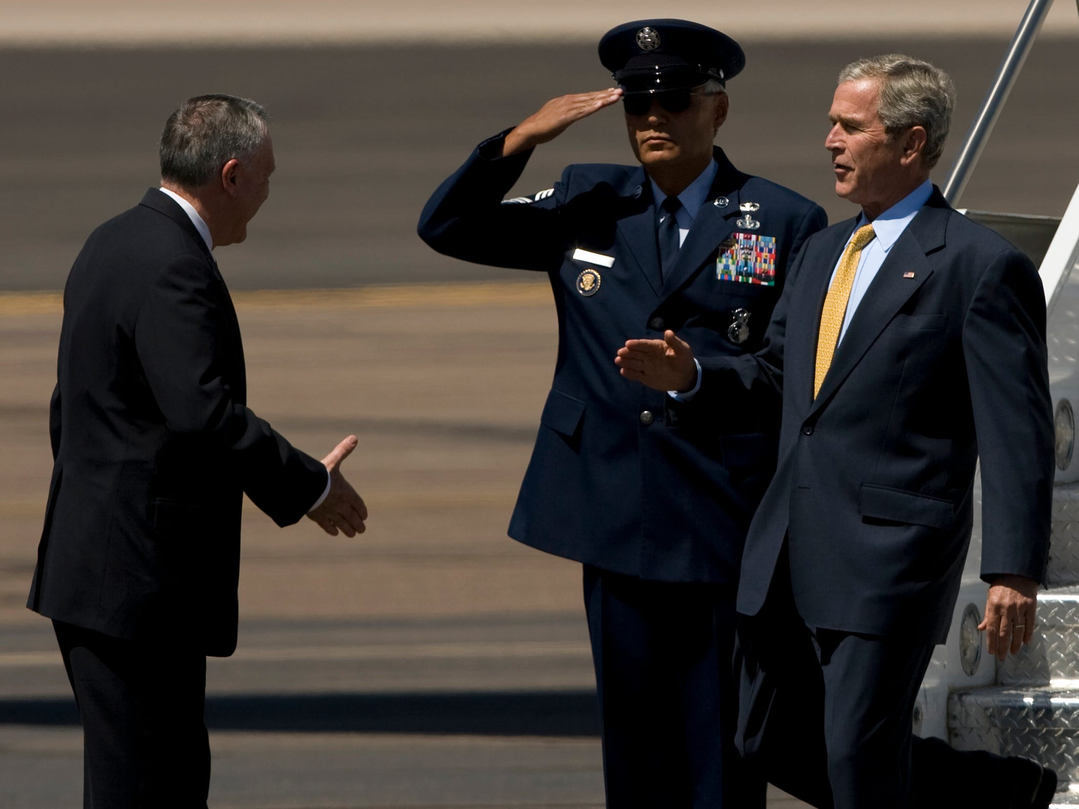 President George W. Bush goes to shake the hand of Sen. Jon Kyl after walking off of Air Force One at the Executive Terminal at Sky Harbor International Airport, May 27, 2008. Bush was in the Valley to campaign for Senator John McCain.