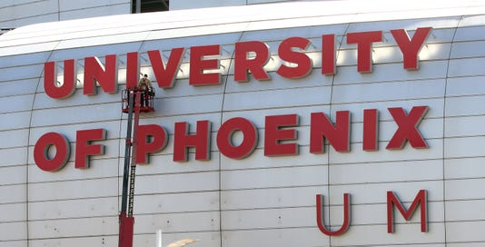 State Farm Stadium Workers Remove The University Of Phoenix