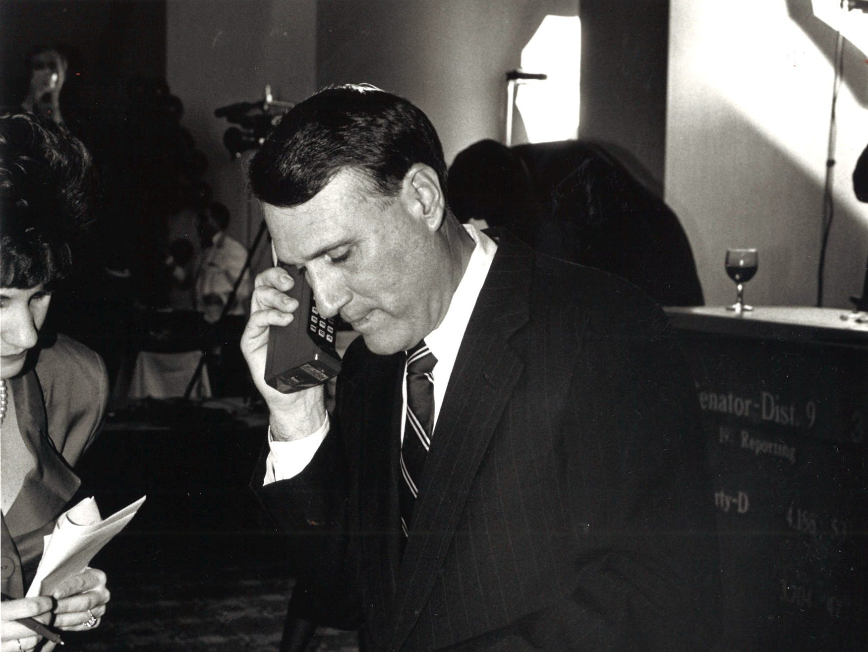Jon Kyl at a local hotel calling for updates on Election Night, Nov. 8, 1990.