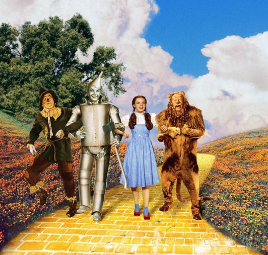 "A scene from the 1939 classic ""The WIzard of Oz."" Pictured from left: Ray Bolger (Scarecrow), Jack Haley (Tin Man), Judy Garland (Dorothy) and Bert Lahr (Cowardly Lion)."