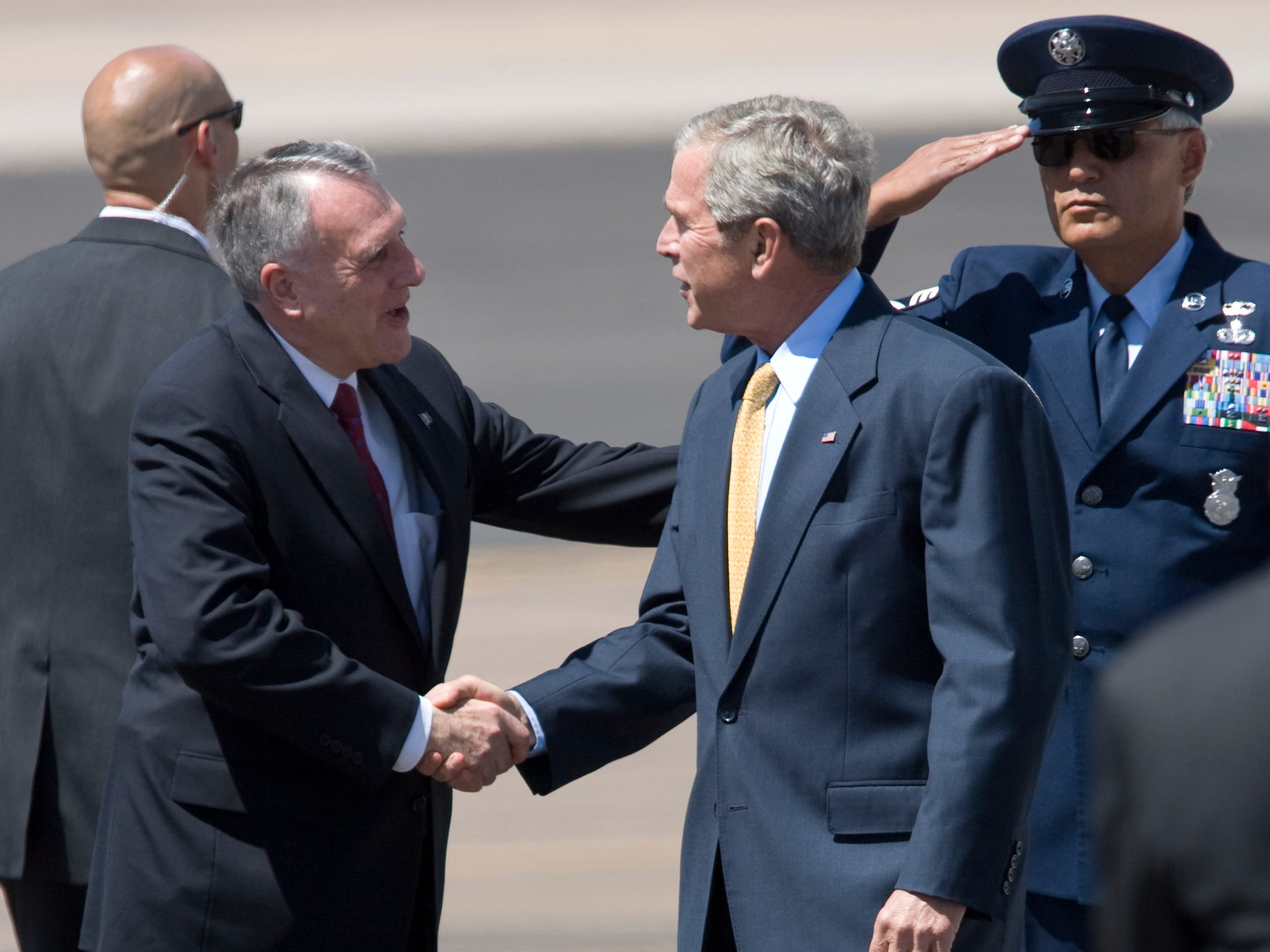 President George W. Bush, right, is greeted by Sen. Jon Kyl, left, after arriving at Sky Harbor International Airport, May 27, 2008.