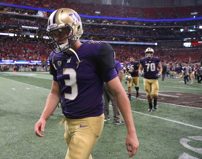 Washington Huskies quarterback Jake Browning (3) walks off of the field after their loss to the Auburn Tigers at Mercedes-Benz Stadium.