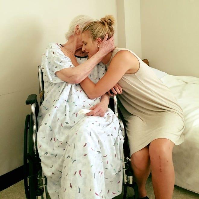 Emily Broughton embraces her grandma, Barbara, in July 2017.