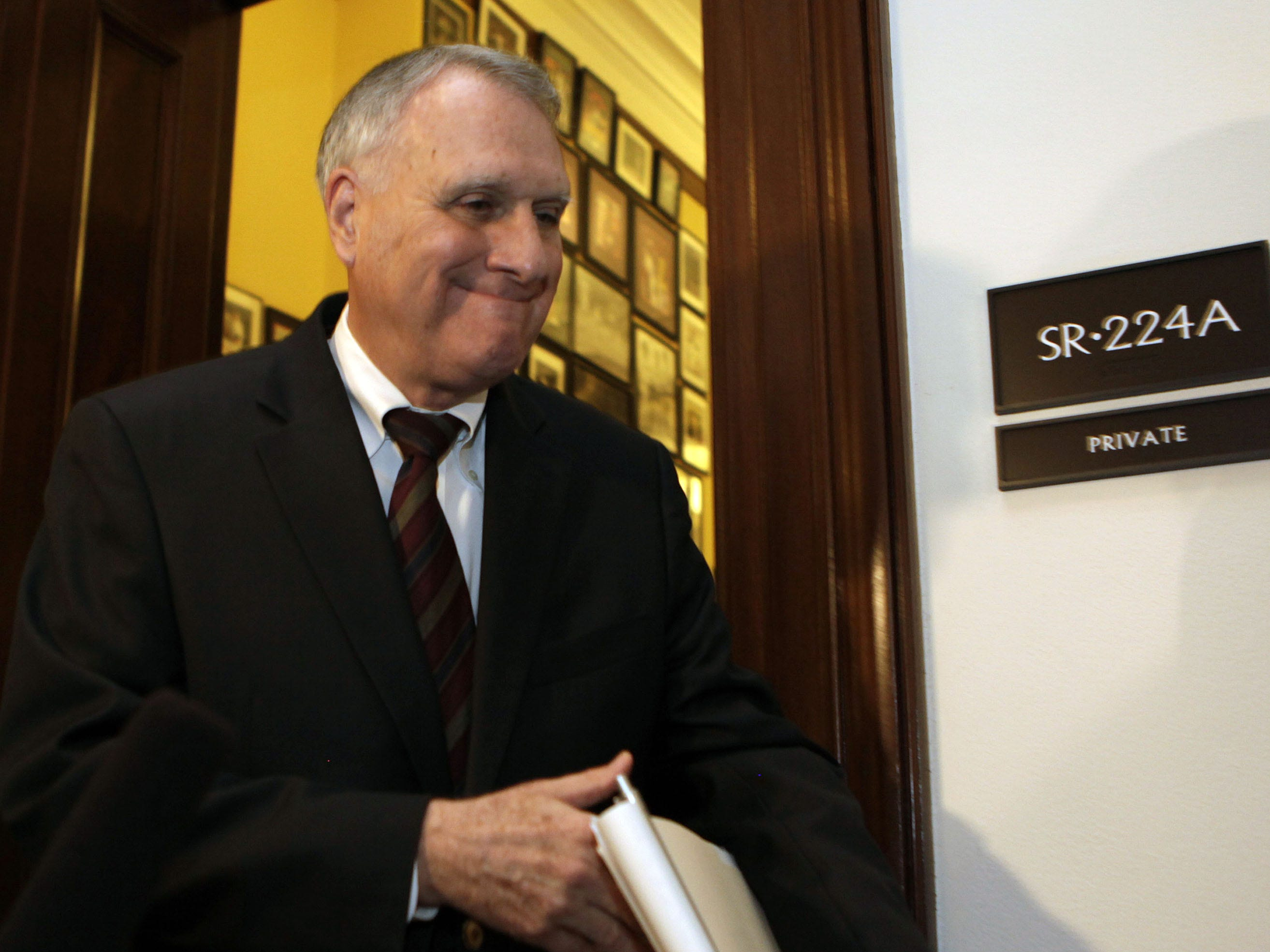 "Super committee Sen. Jon Kyl leaves after the meeting between Republican and Democratic members of the ""Super Committee,"" or Joint Select Committee on Deficit Reduction, on Nov. 21, 2011 on Capitol Hill in Washington, DC."