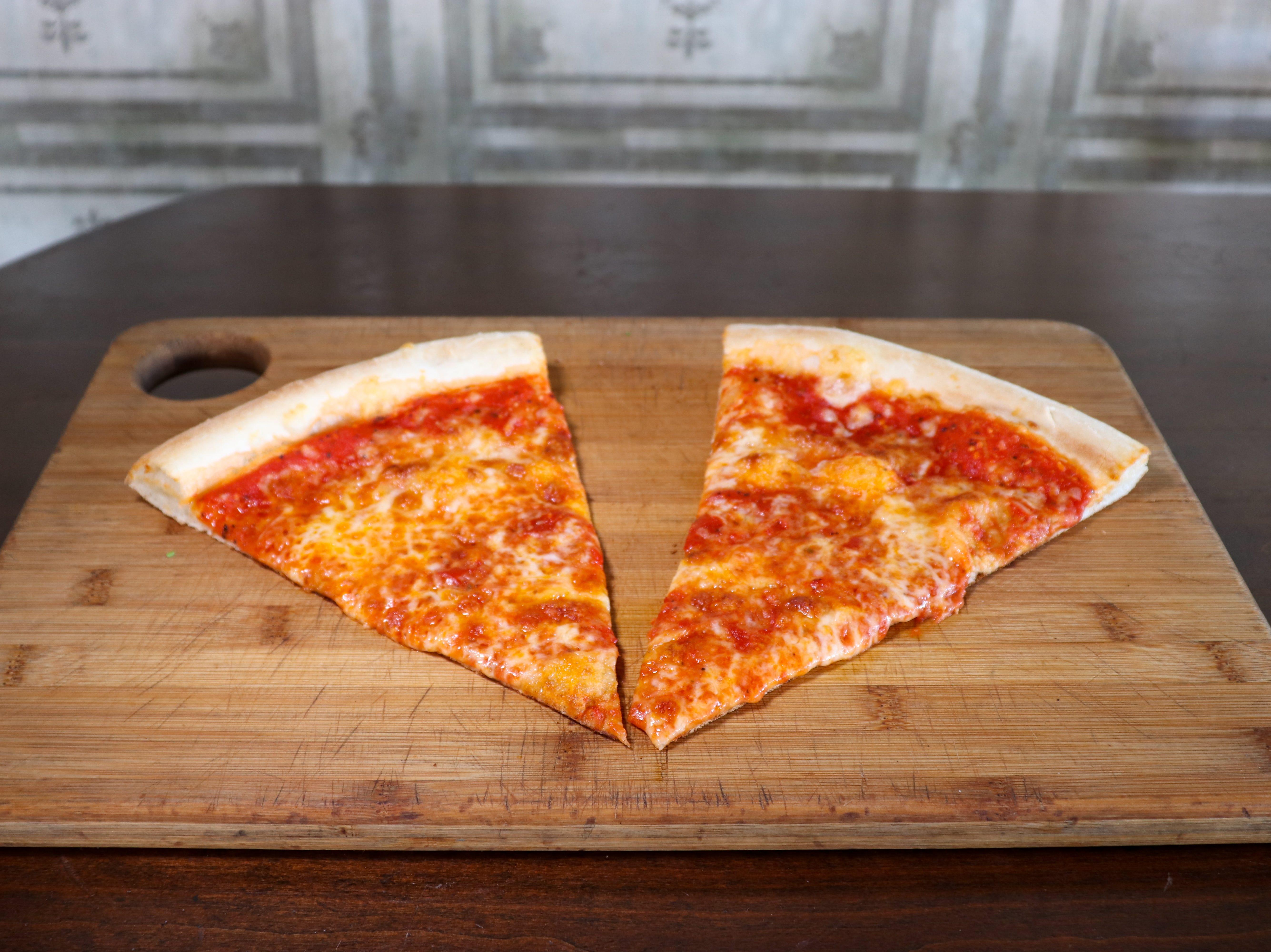 Pizza slices at Crust Pizzeria and Italian Restaurant.