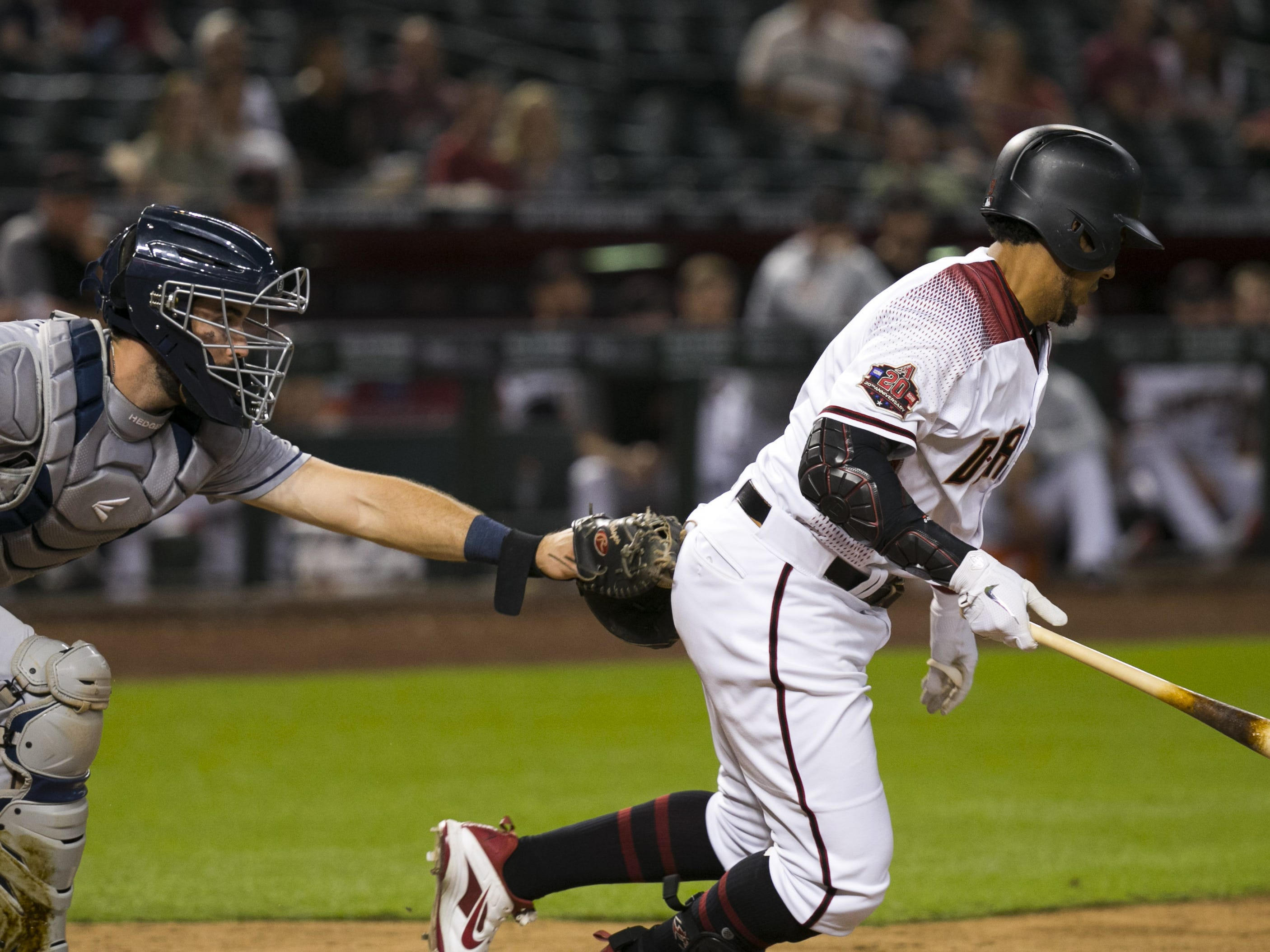 Padres catcher Austin Hedges tags out the  Diamondbacks John Jay on the final out of the game at Chase Field in Phoenix on Monday, September 3, 2018. The Padres won the game 6-2.