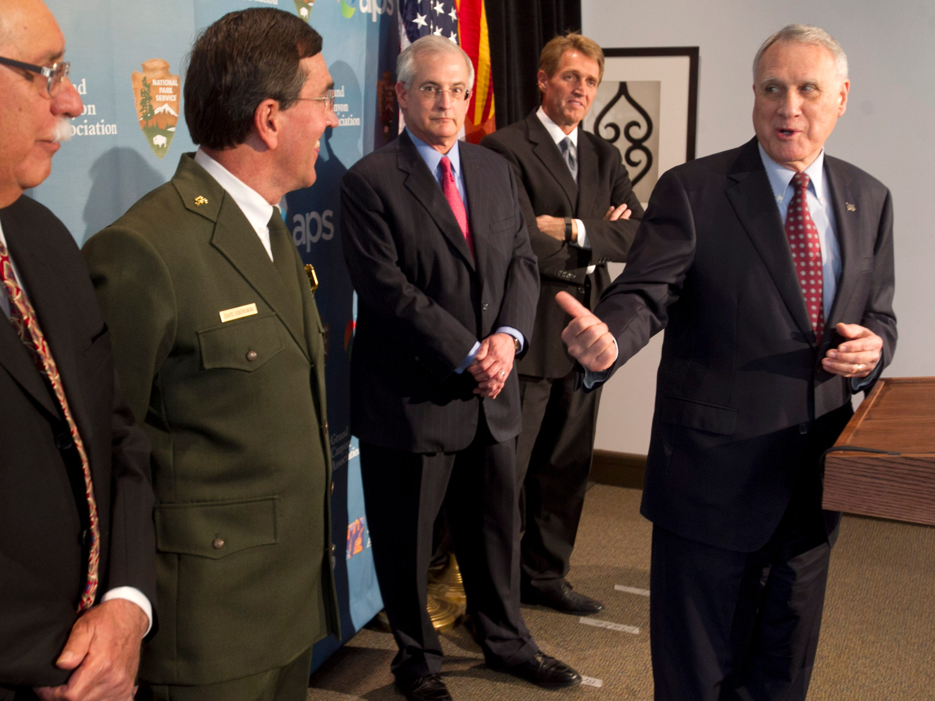 Former U.S. Senator Jon Kyl speaks as (from left) U.S. Representative Ed Pastor, Grand Canyon National Park Superintendent David Uberuaga, Donald Brandt, Chairman of the Board and CEO of APS and U.S. Senator Jeff Flake look on during a press conference at the Heard Museum, Feb. 7, 2014.