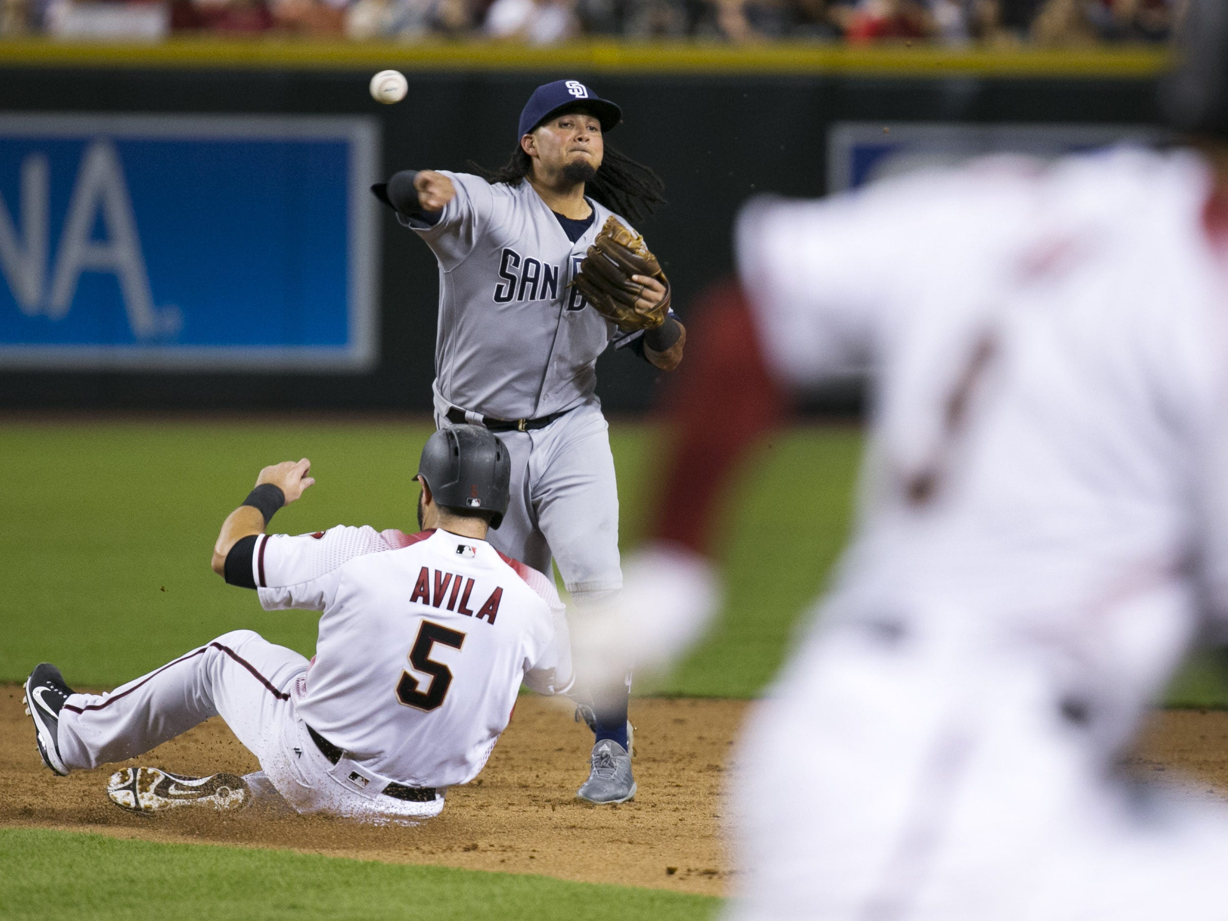 Padres shortstop Freddy Galvis turns a double play against the Diamondbacks Alex Avila sliding into second as the Diamondbacks John Jay runs to first during the fifth inning of the major league baseball game at Chase Field in Phoenix on Monday, September 3, 2018.