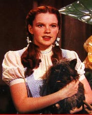 "Judy Garland as Dorothy, with Toto, in ""The Wizard of Oz in 1939."