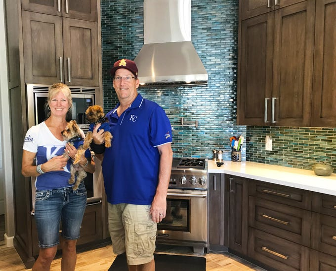 Dave and Mona MacNay, retired air traffic controllers,  in their newly remodeled kitchen. The project cost the homeowners $86,000.