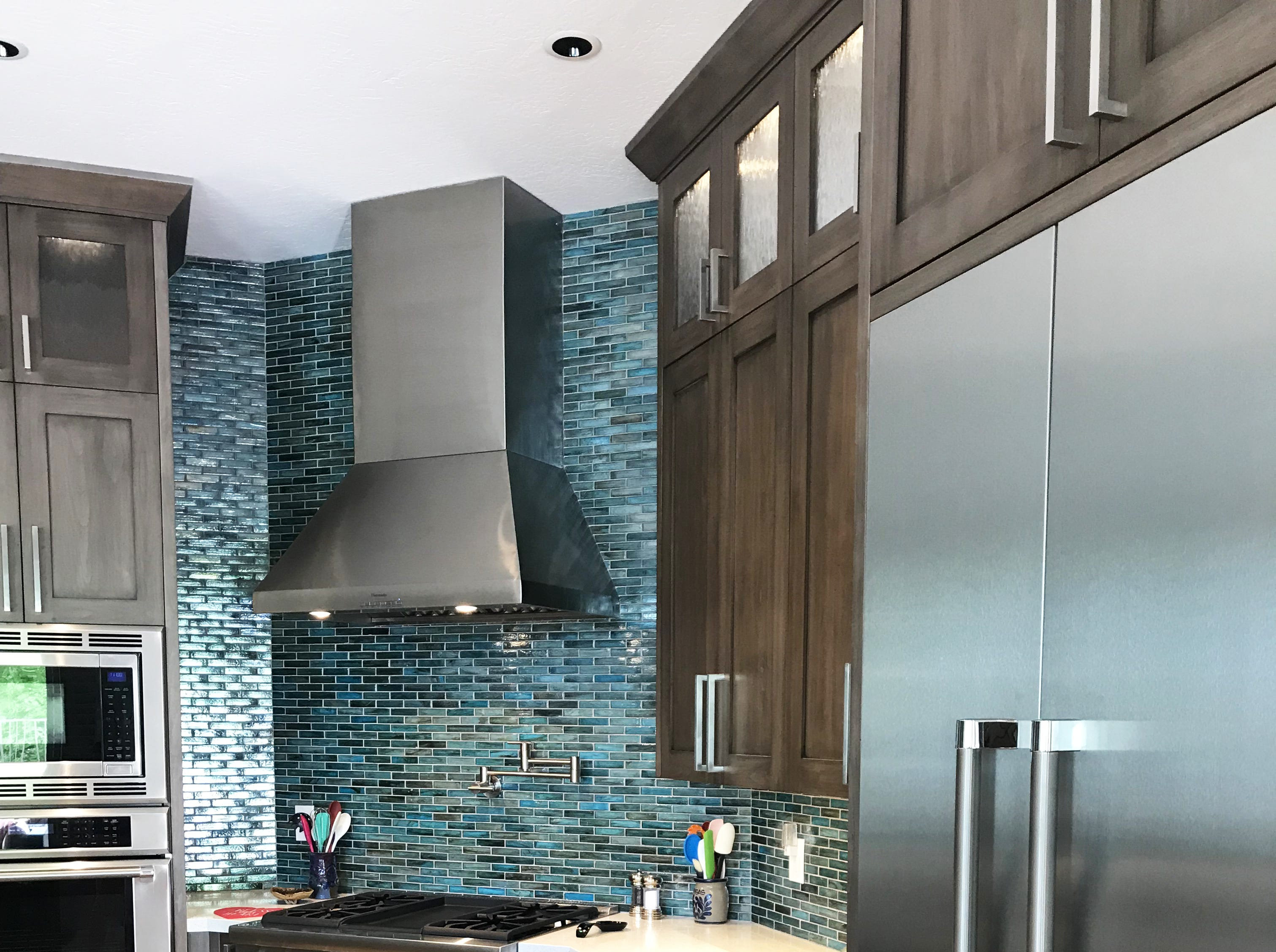 When the old kitchen was demolished, Dave focused on the plumbing and electrical work, while Mona and interior designer Arteaga found the stained alder wood cabinets and backsplash tiles.